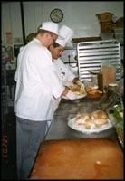 Chefs working in restaurant