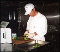 Employee preparing food