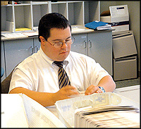 MBNA employee sorting mail