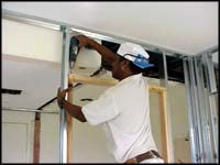 Carpenter repairing ceiling