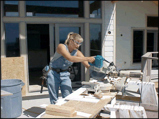 Carpenter cutting plywood